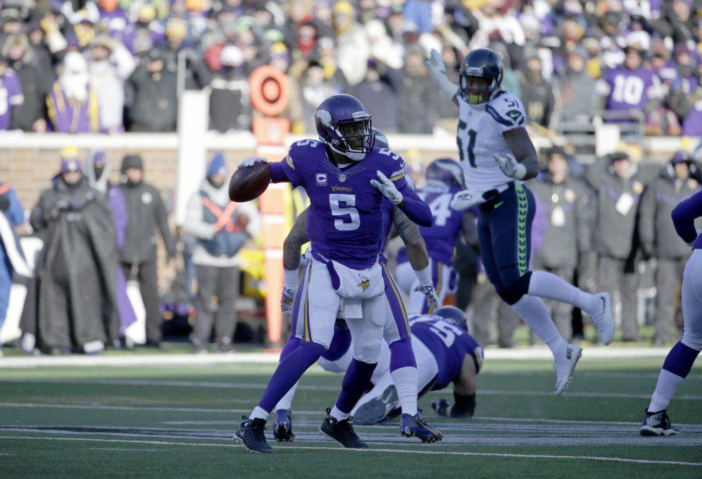 c0fc7d7fd70 Minnesota Vikings quarterback Teddy Bridgewater (5) throws during the first  half of an NFL