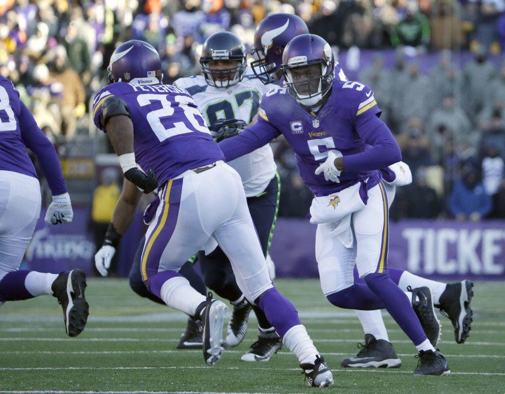 d42d548d1c1 Minnesota Vikings quarterback Teddy Bridgewater (5) hands off the ball to  running back Adrian