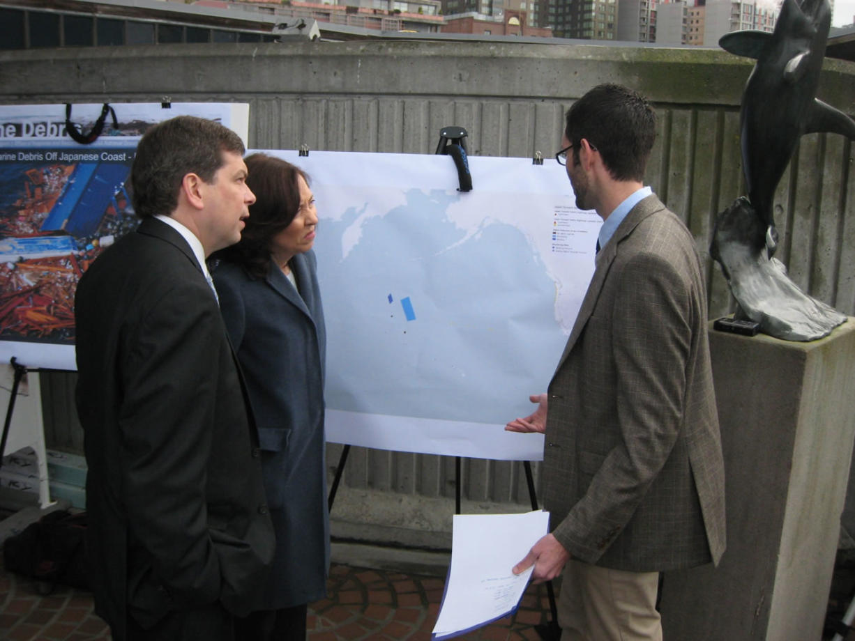U.S. Sens. Mark Begich and Maria Cantwell talk to Peter Murphy with the marine debris program at the National Oceanic and Atmospheric Administration in Seattle, about the way tsunami debris is expected to cross the Pacific Ocean from Japan to the U.S. coast.