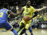 Oregon's Dwayne Benjamin, takes a step towards the basket during the first half of an NCAA college basketball game against UCLA Saturday, Jan. 23, 2016, in Eugene, Ore.