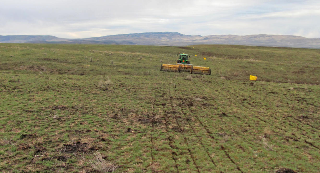 A rangeland drill reseeds an area burned by the Soda Fire in Southwest Idaho. A year after Interior Secretary Sally Jewell shifted the national approach to fighting wildfires across a wide swath of sagebrush country in the West, her strategy is turning out to be one of the most significant federal land policy changes in some 80 years, public land experts, outdoor enthusiasts and scientists say.