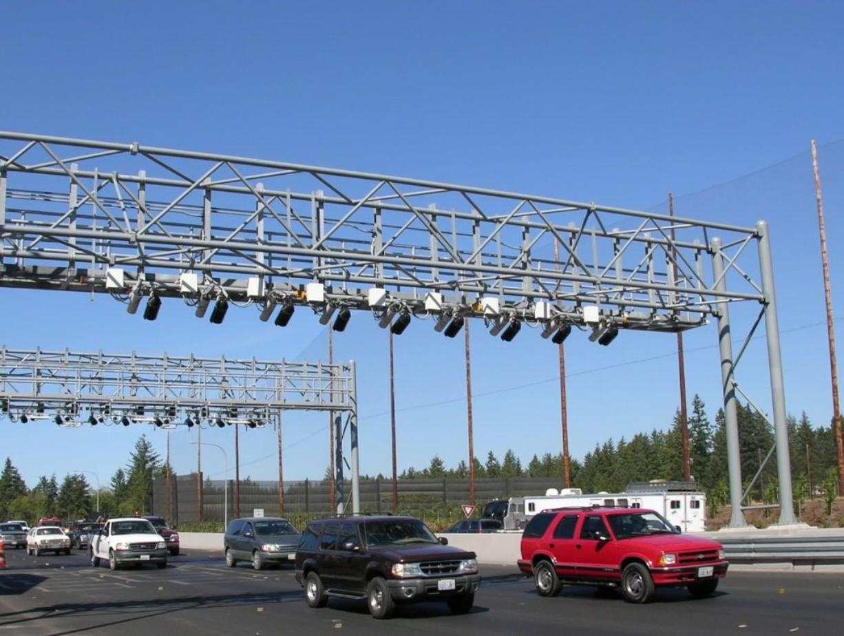 Electronic toll lanes at the Tacoma Narrows Bridge allow cars to cross the bridge without stopping at toll booths.