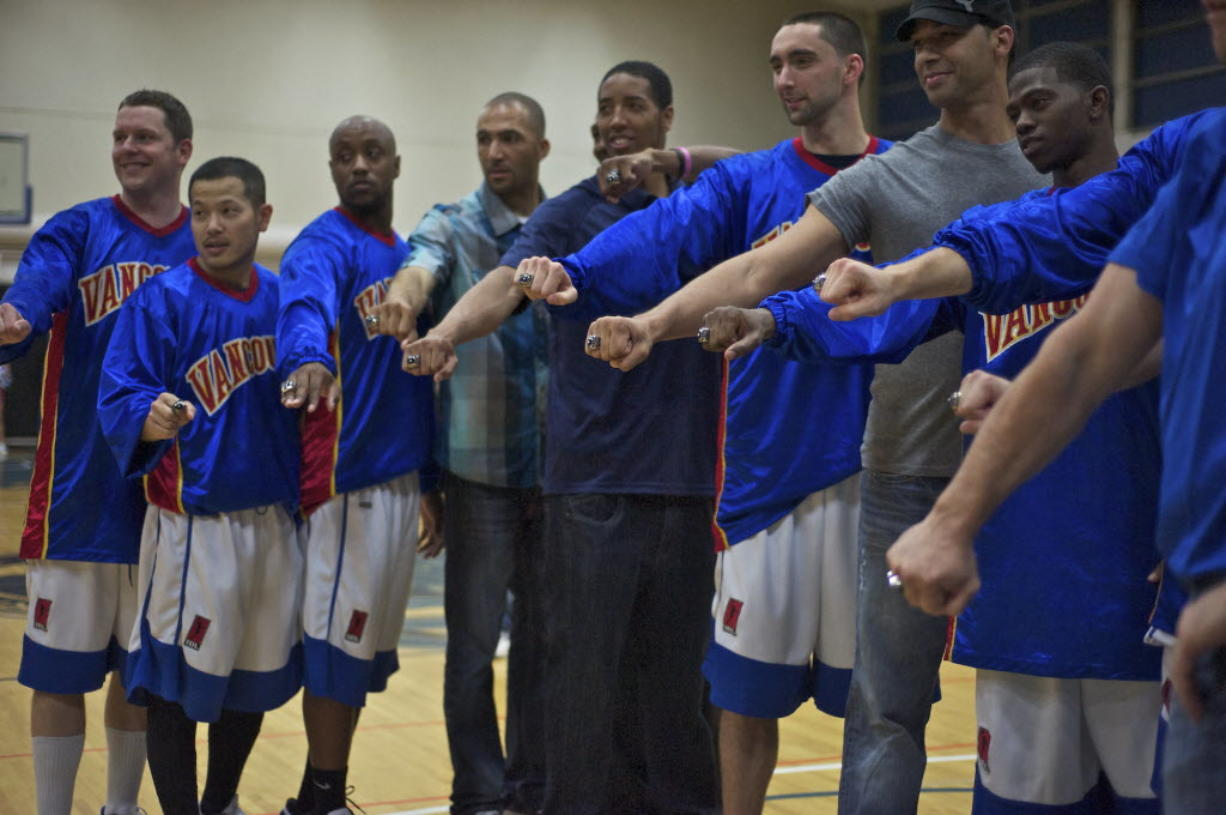 The Vancouver Volcanoes pose with their 2011 IBL Championship rings before their game against the Bellingham Slam at Clark College on Friday.