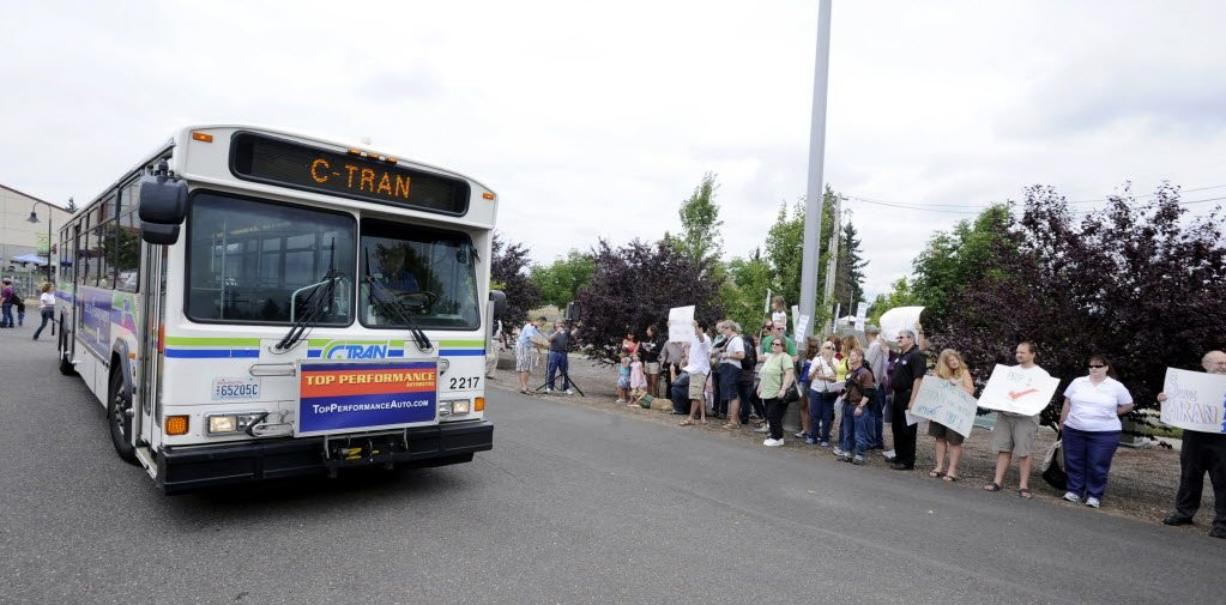 A C-Tran bus passes a group of supporters of Proposition 1 in August as they rally for a C-Tran sales tax increase outside the Clark County Fair. The measure was approved.