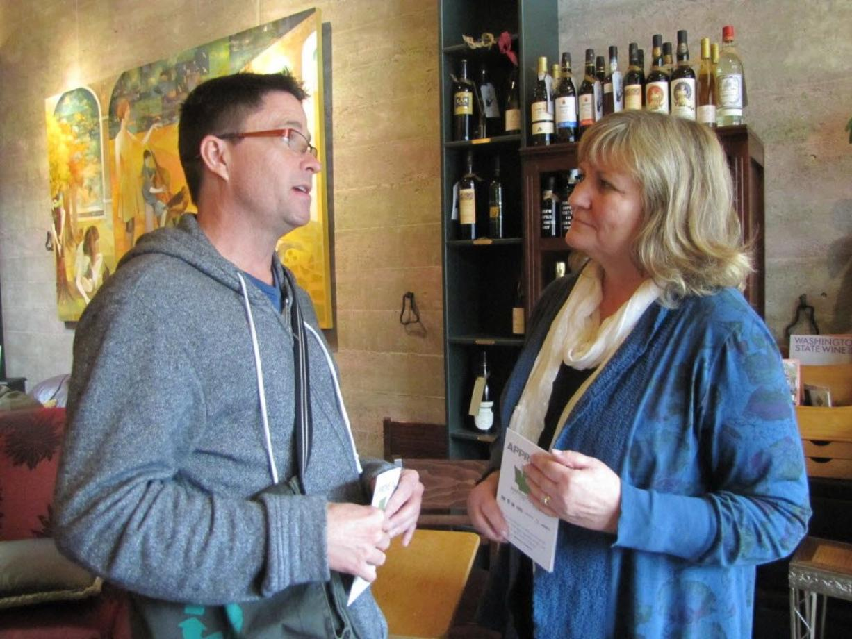 Trudi Inslee, wife of gubernatorial candidate Jay Inslee, discusses gay and lesbian rights with Steve Herndon of Vancouver during a meet and greet Tuesday at downtown Vancouver's Niche Wine and Art Bar.