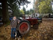 """Jim Fisher, with his dog, Buddy,  calls himself """"the old hermit of Skunk Hollow."""" A resident of Fern Prairie since 1969 and member of the Fern Prairie Homeowner Association, he is representative of the well-rooted, older residents who inhabit this rural area and drive up its median age to the oldest of any community in Clark County."""