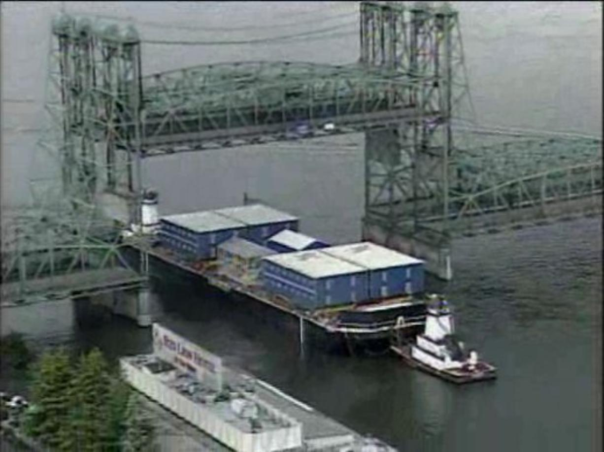 A barge loaded with equipment destined for Alaska passes through the Interstate 5 Bridge earlier this year.