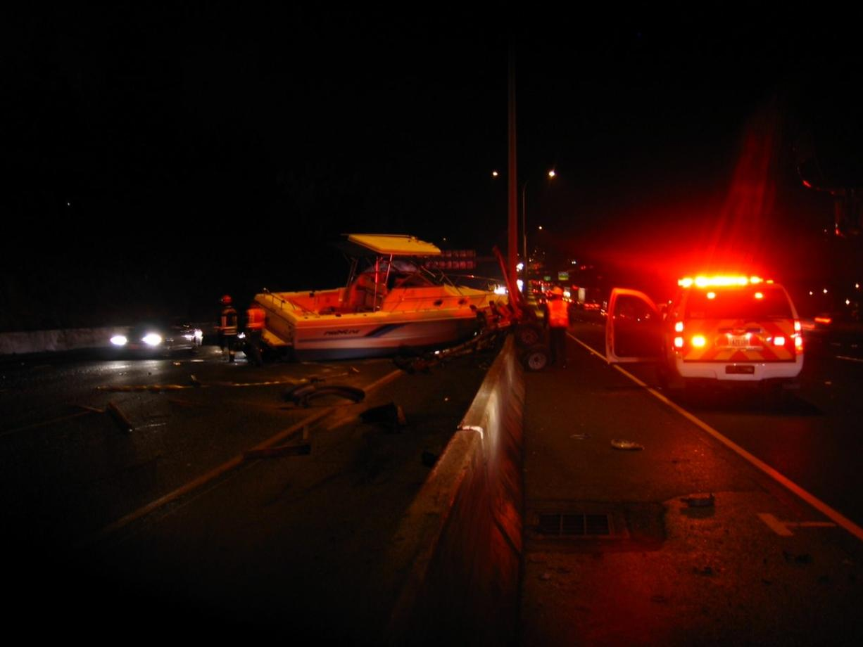 A boat ended up in the southbound lanes of Interstate 5 on Thursday after a truck hauling the boat northbound crashed into a concrete divider.