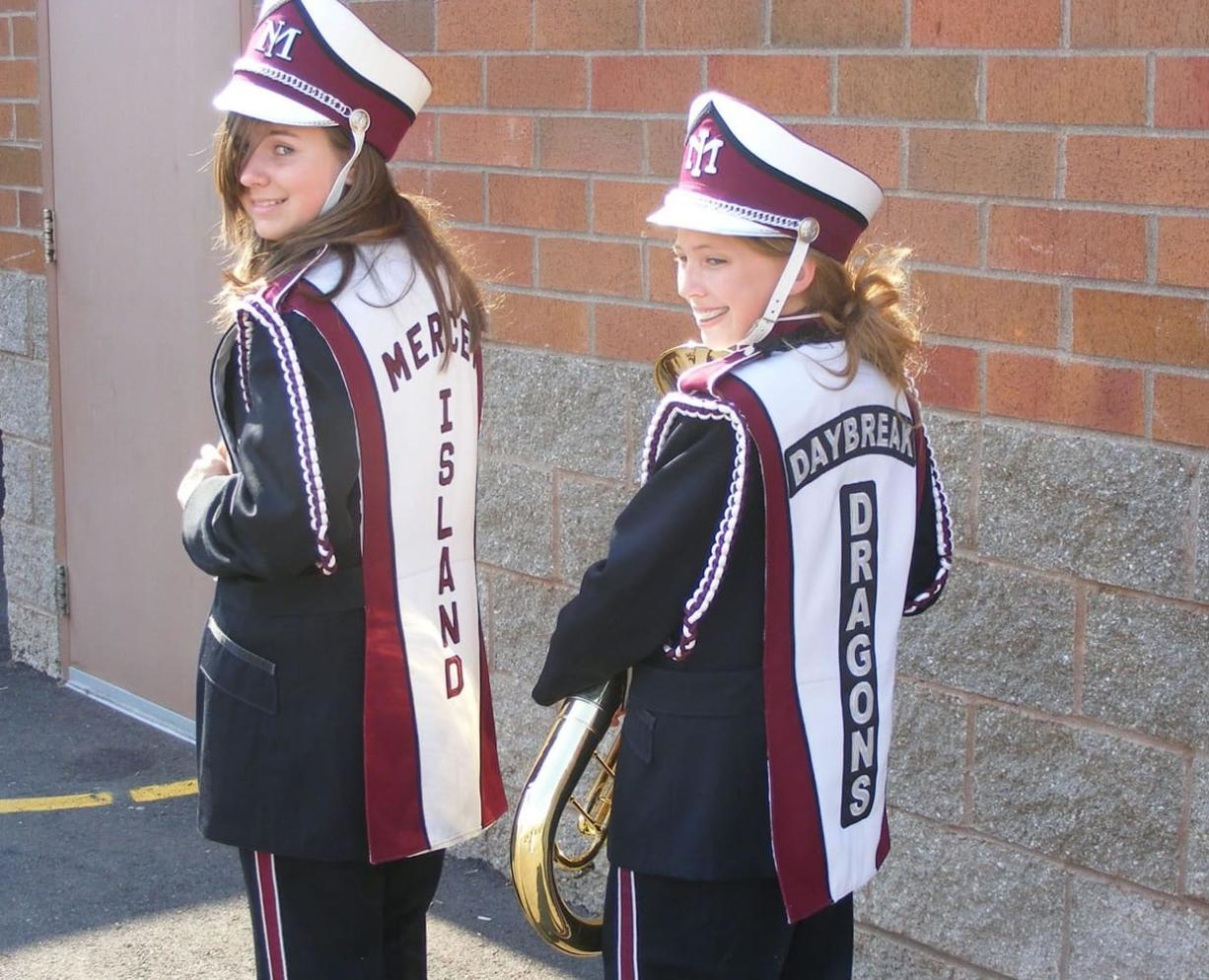 Daybreak Middle School seventh-graders Jessie Wiseman, left, and Briana Robbins, display the uniform overlays, one with the Mercer Island identifier and one with new Daybreak Dragons patches.