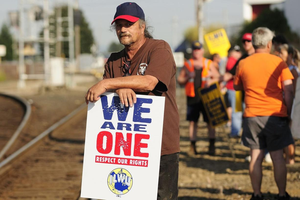 ILWU workers protest along rail lines on 8th Street on Wednesday in Vancouver.