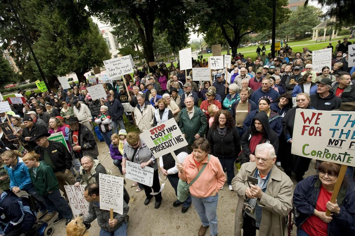 An estimated 700 demonstrators participated in Occupy Vancouver, first meeting at Esther Short Park and then marching through downtown Vancouver on Saturday.