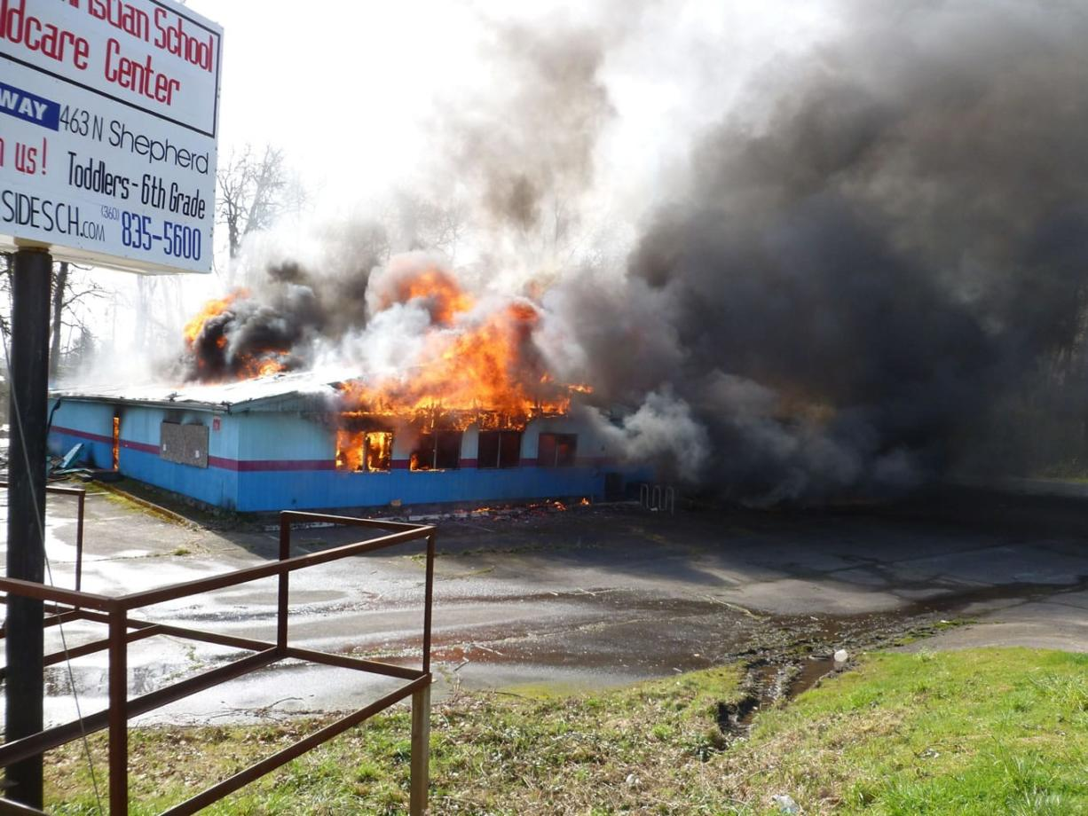 The former Riverside Bowling Alley in Camas burns Saturday morning as part of a training exercise by the Camas Fire Department.