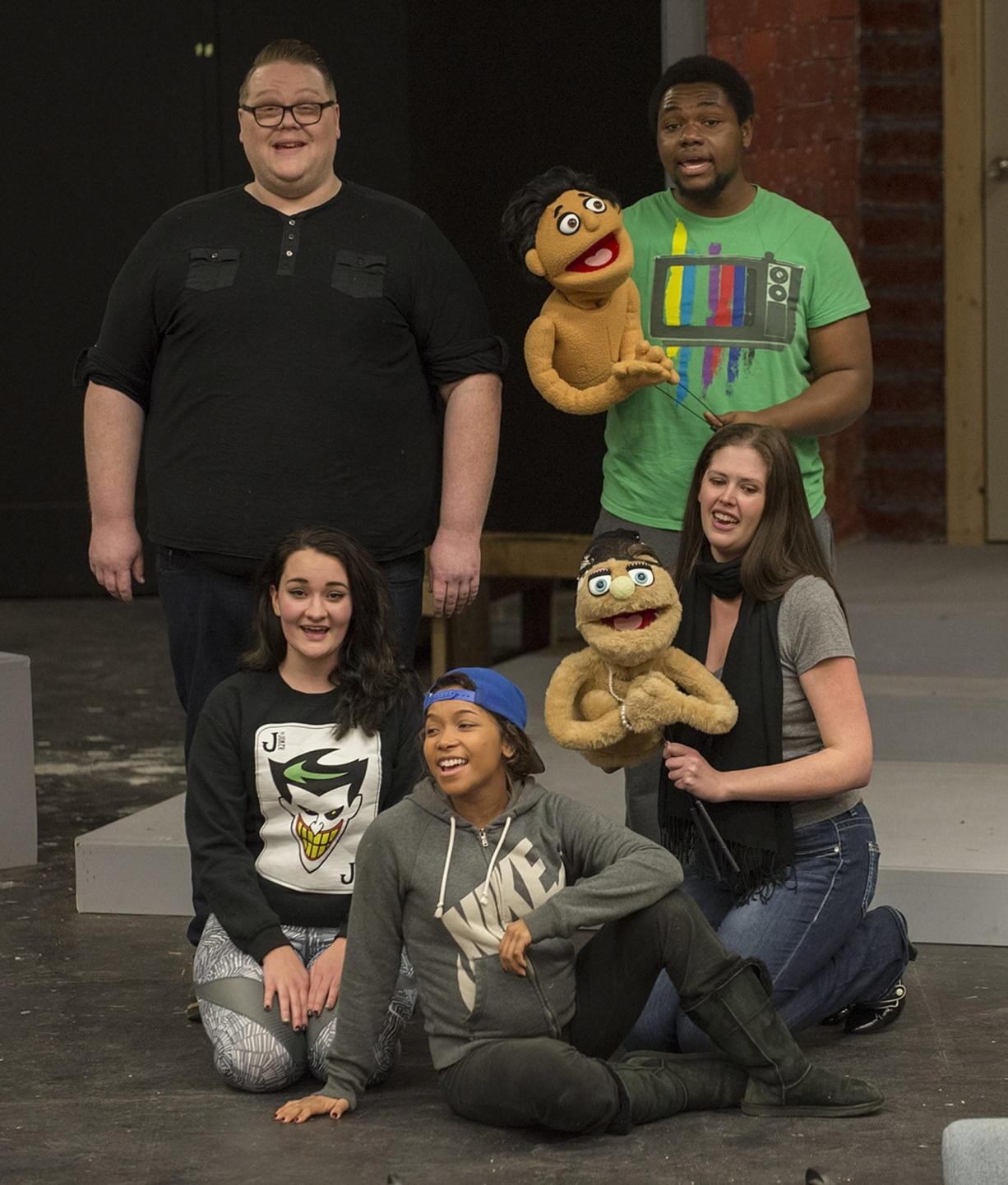 """Tristan James as Brian (clockwise from top left), Timothy Busch with puppet Princeton, Jacqueline Baxter with Kate Monster, Kiara Gaulding as child star Gary Coleman -- yes, THAT Gary Coleman -- and Kennedy Marvin as Christmas Eve prepare for the upcoming Clark College musical production of """"Avenue Q."""" (Amanda Cowan/The Columbian)"""