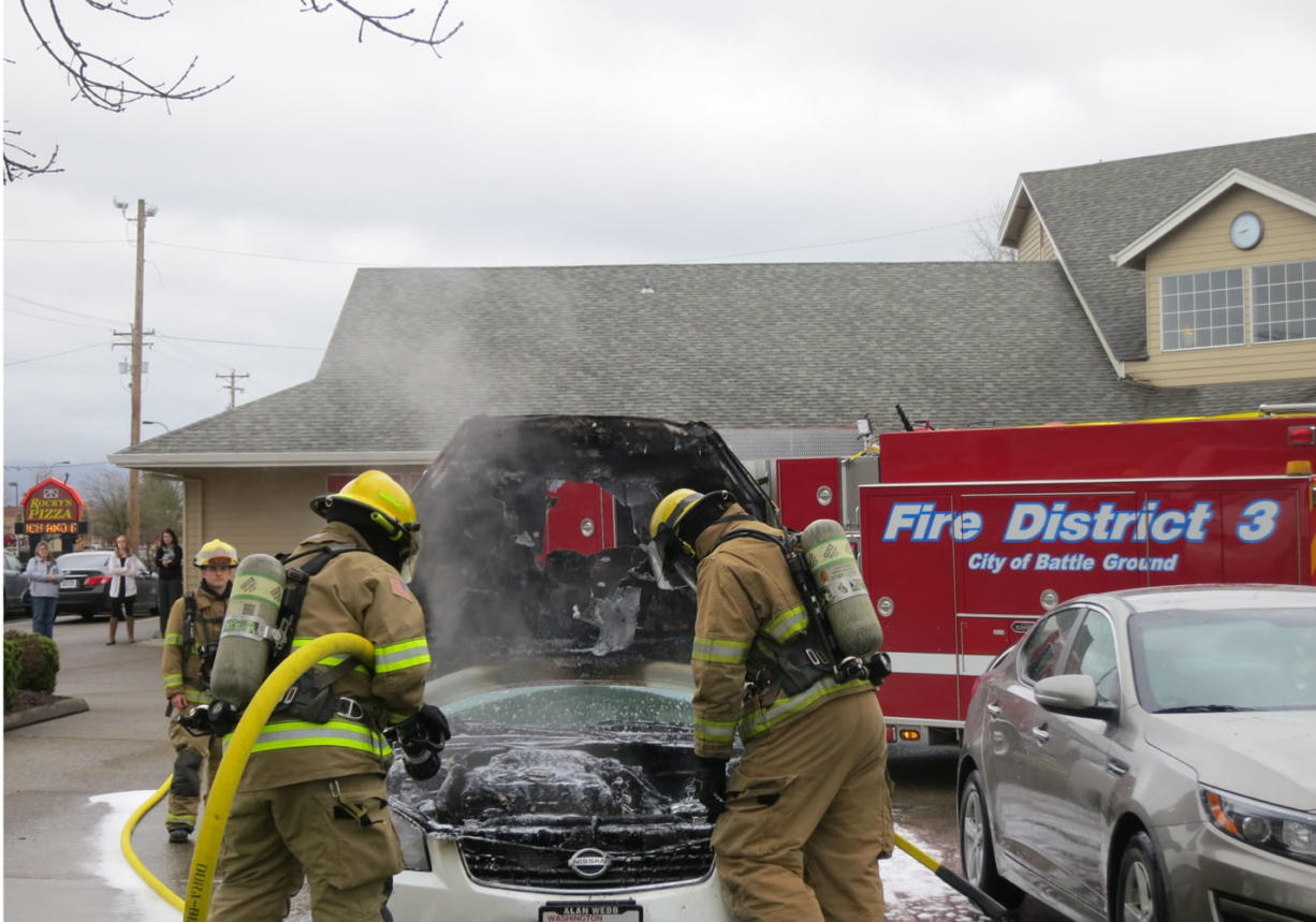 Firefighters douse a car fire at 15 S..W 20th Ave. in Battle Ground Monday morning. (Clark County Fire District 3)