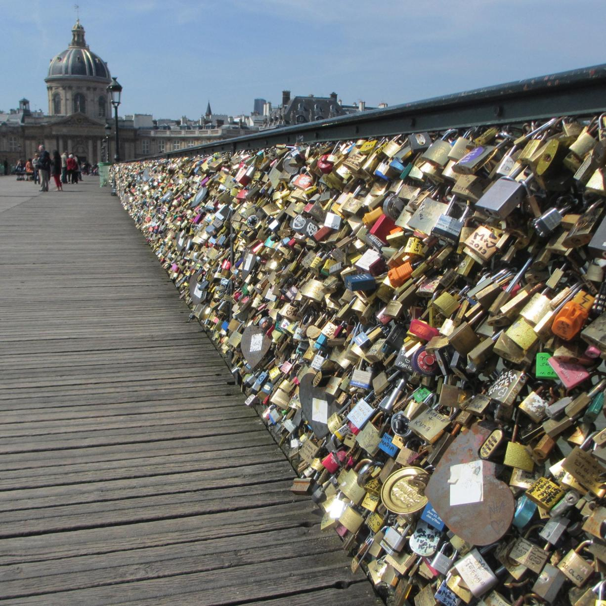 """Love can get heavy. Paris, the """"capital of romance,"""" according to its deputy mayor, cut 45 tons of padlocked """"commitment"""" off of the Pont des Arts pedestrian bridge in the summer of 2015. It didn't fish the more than 700,000 keys out of the water, though. (Scott Hewitt/The Columbian)"""
