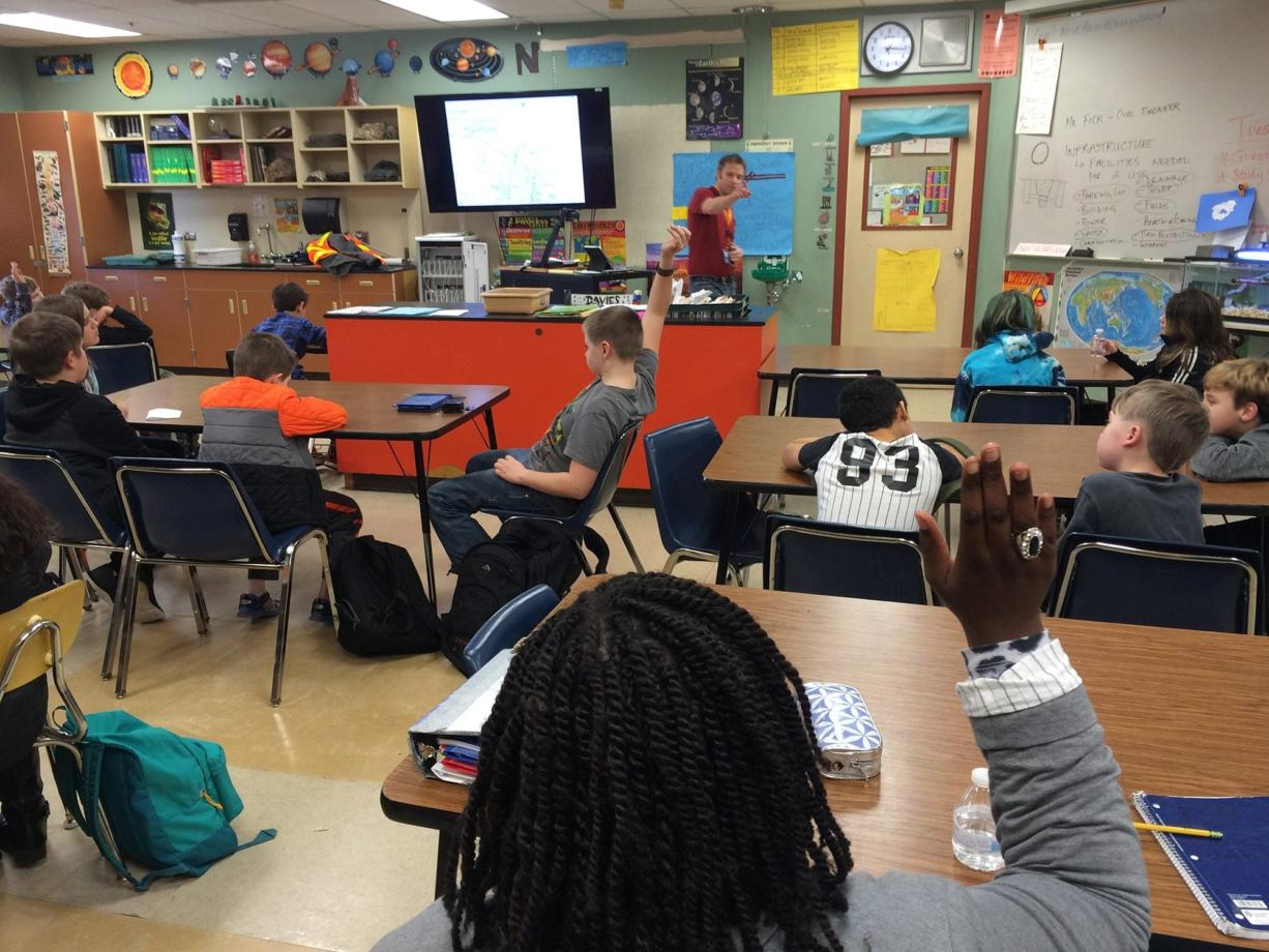 Washougal: Jeremy Fick, a civil engineer from Robertson Engineering in Vancouver, talking to Jemtegaard Middle School sixth-graders about his work in designing a new school being built near the middle school.