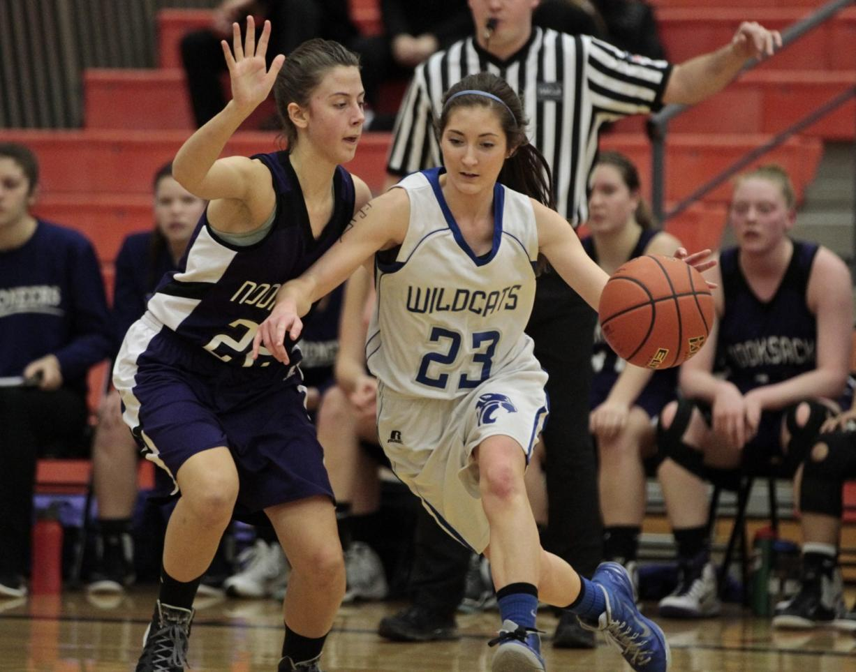 La Center's Andrea Griffee (23) drives on Nooksack Valley's Jenna Tenkley during Saturday's 1A state regional playoff game at Battle Ground High School.