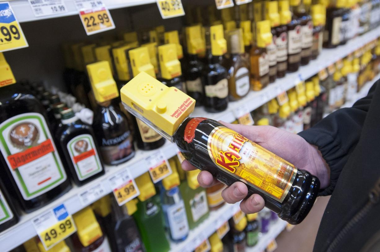 Liquor is more widely available but also more expensive four years after voters kicked the state out of spirits sales and privatized the liquor market. (Natalie Behring/ The Columbian)