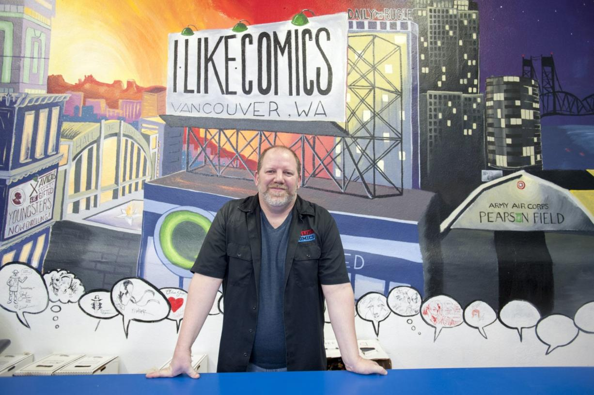 Chris Simons, owner of I like Comics, recently moved the store to larger quarters at 1715 Broadway in downtown Vancouver. The store's mural behind Simons was painted by some customers.