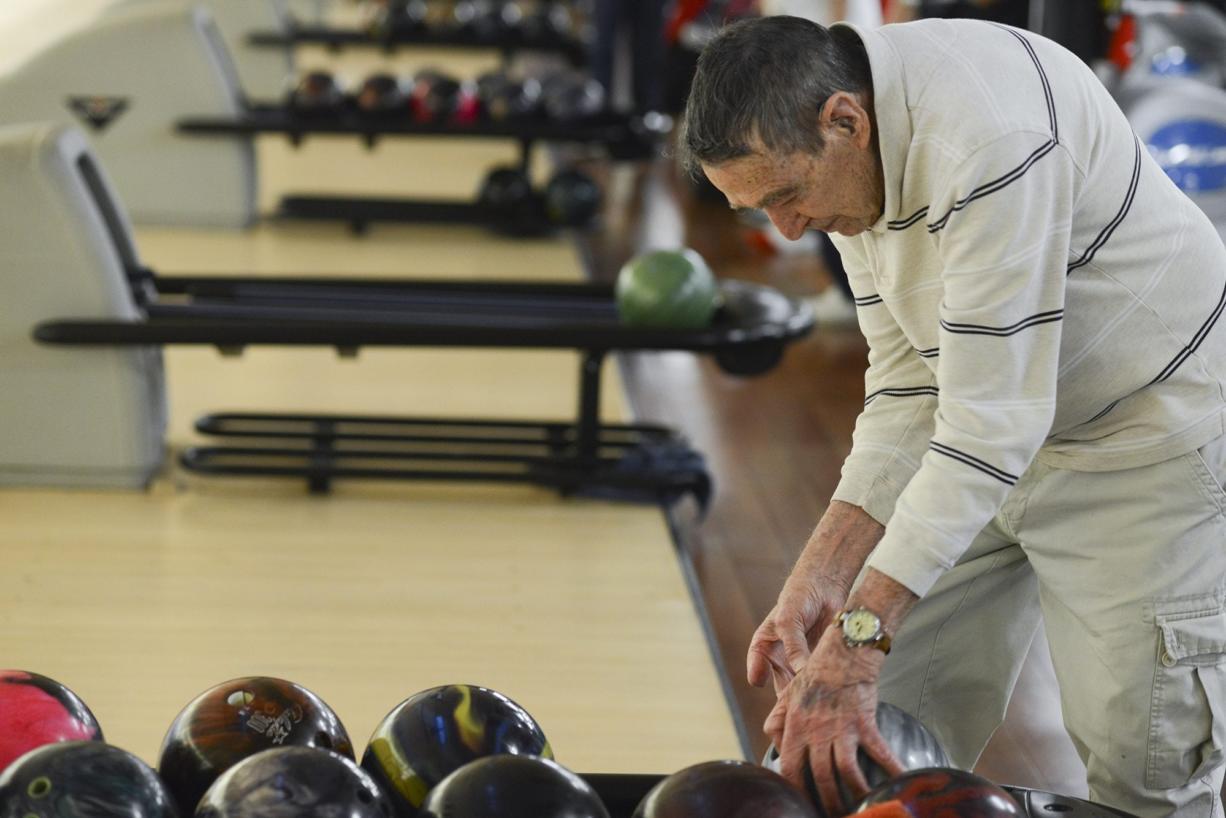 John Hallett bowls three days a week. He says he enjoys the exercise.
