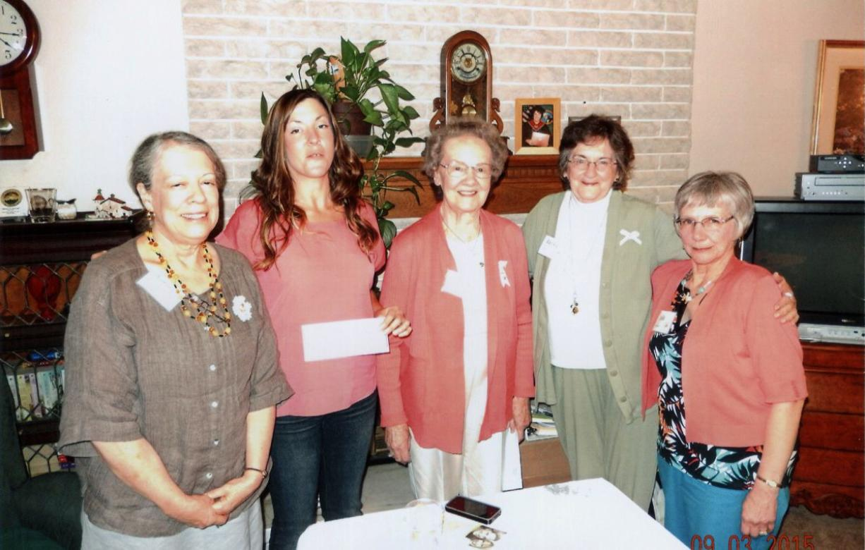 Battle Ground: Philanthropic Educational Organization members Anna Morrison, left, Beverly Osieck, from center, Becky Robert and Julie Tanner present an education grant to Melissa Macaree, second from left.