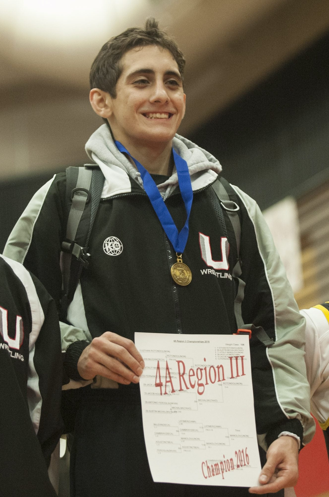 Ethan Rotondo of Union High School on the winners podium at the 4A Regional Wrestling Tournament in Camas Saturday February 13, 2016.  (Natalie Behring/ The Columbian)