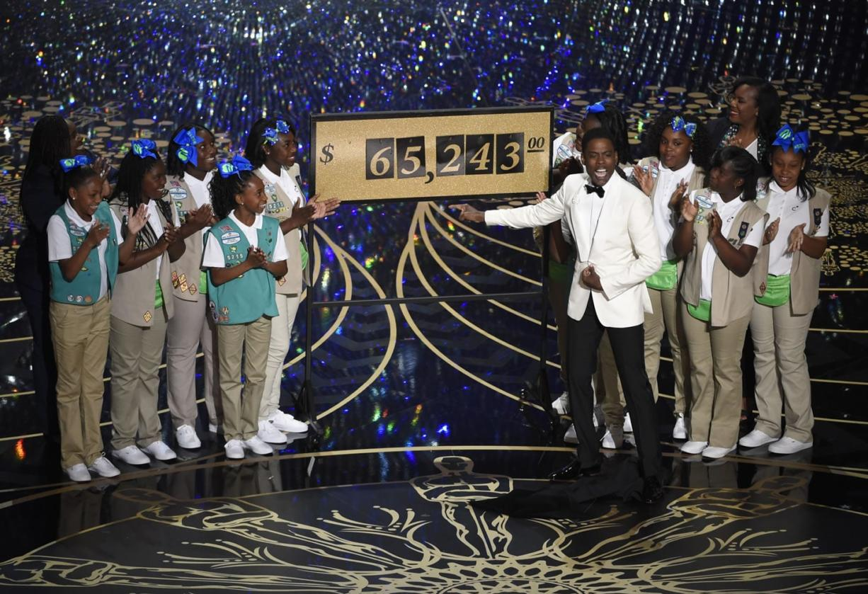 Host Chris Rock and Girl Scouts participate in a skit at the Oscars on Sunday, Feb. 28, 2016, at the Dolby Theatre in Los Angeles. (Photo by Chris Pizzello/Invision/AP)