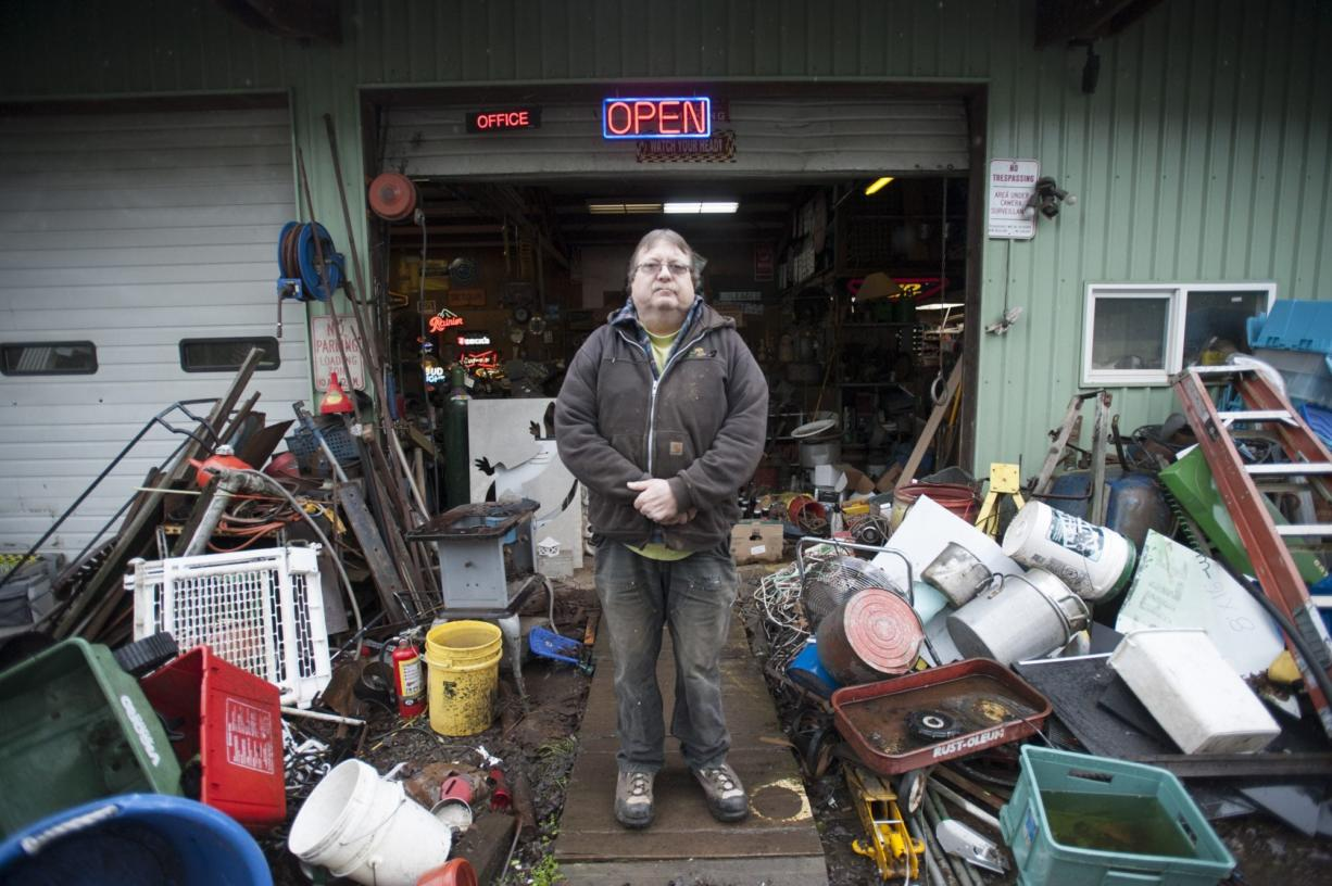 """Dean Yankee stands amid his inventory at Yankee's Custom Farming outside of Battle Ground in December. The 59-year-old says he has """"moved a mile and a half my whole life here"""" and turned the family farming services business into a garage sale for those who don't want to hold their own."""