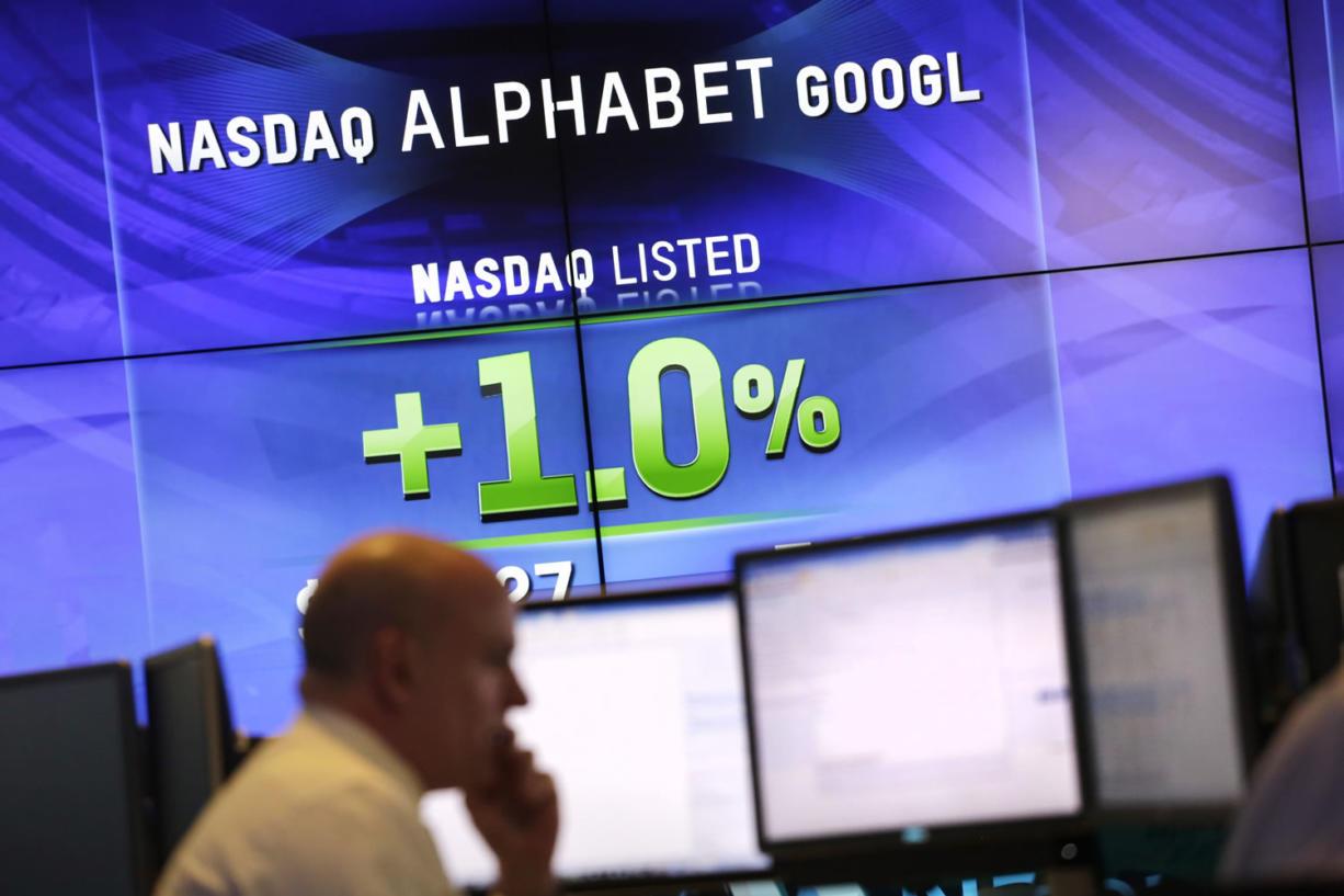 Electronic screens post the price of Alphabet stock Monday at the Nasdaq MarketSite in New York. (Mark Lennihan/Associated Press)