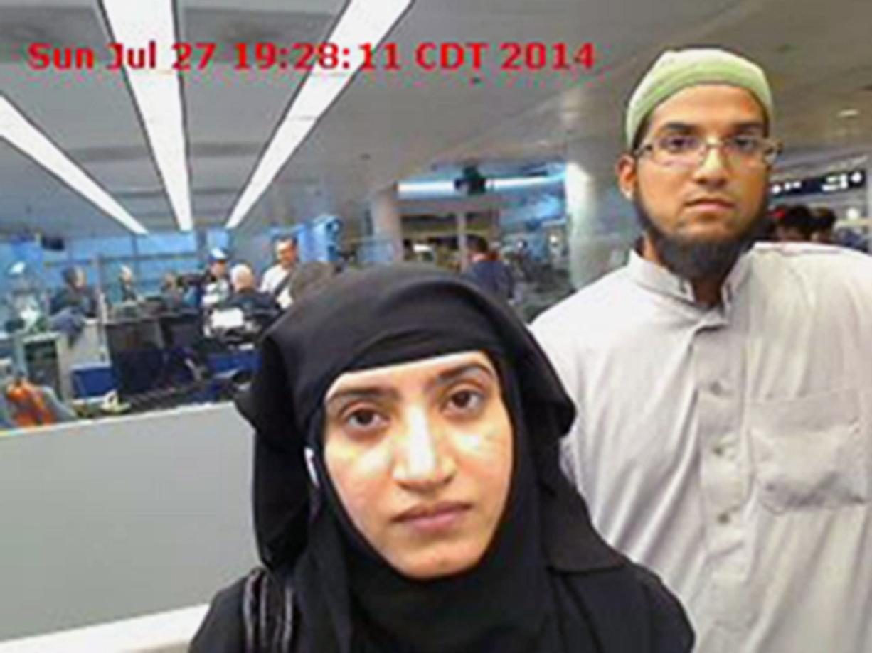A photo of Tashfeen Malik, left, and her husband, Syed Farook, was captured in 2014 at O'Hare International Airport in Chicago. A schism has emerged among family members of victims and survivors of the San Bernardino, Calif., terrorist attack, with at least a couple supporting Apple Inc. in its battle against a federal court order to help the FBI hack into a shooter's locked iPhone. (U.S. Customs and Border Protection)