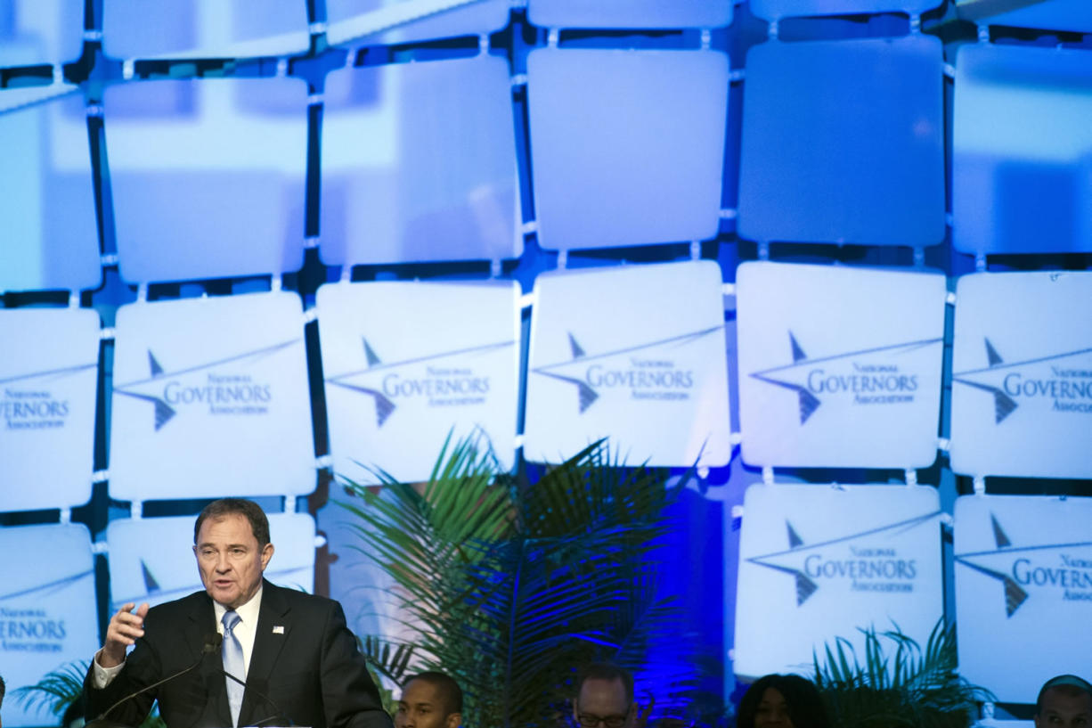 National Governors Association Winter Meeting Chair Utah Gov. Gary Herbert speaks during the opening session Saturday in Washington.