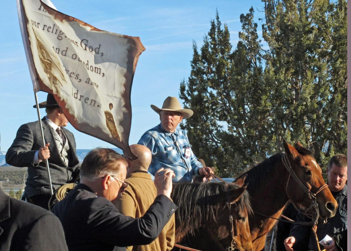 "Cliven Bundy, on horseback at center, joins the funeral procession for Arizona rancher Robert ""LaVoy"" Finicum in Kanab, Utah, on  Feb. 5. Hundreds of people packed a Mormon church in rural Utah for the viewing ceremony for the fallen spokesman of the Oregon armed standoff. Police shot and killed Finicum during a Jan. 26 traffic stop after they say he reached for a gun."