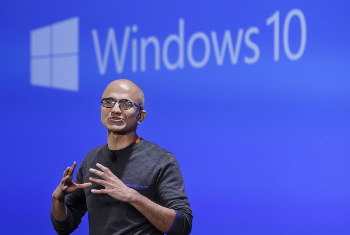 Microsoft CEO Satya Nadella speaks at an event demonstrating the new features of Windows 10 at the company's headquarters in Redmond. If you're running an older version of Windows, you might suddenly find Microsoft's Windows 10 upgrade already downloaded on your machine. The automatic download, which began the first week of February, is part of Microsoft's aggressive push to get Windows 10 on as many devices as possible.