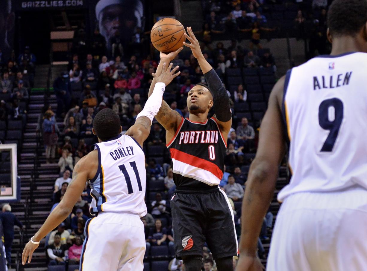 Portland Trail Blazers guard Damian Lillard (0) shoots against Memphis Grizzlies guard Mike Conley (11) in the first half of an NBA basketball game Monday, Feb. 8, 2016, in Memphis, Tenn.