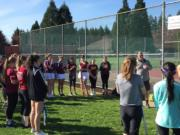 Prairie and Union tennis players receive instructions before the start of junior varsity and C team matches Wednesday at Prairie High School (Micah Rice/The Columbian)
