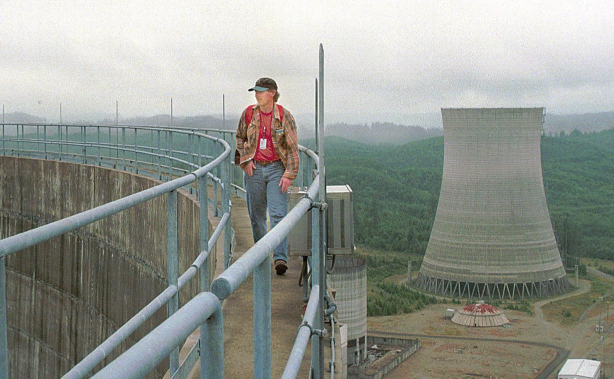 Energy Northwest employee Randy Crawford walks around the top of a cooling tower in Satsop, Wash., in 1999. The Energy Facility State Evaluation Council approved the nuclear project, though it was never completed.