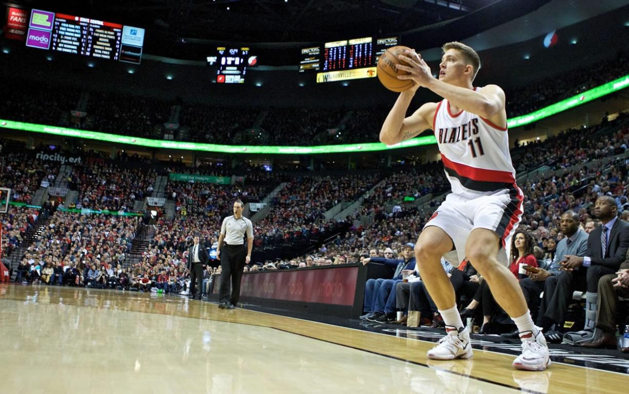 Portland Trail Blazers forward Meyers Leonard shoots a 3-point basket against the Orlando Magic during the second half of an NBA basketball game in Portland, Ore., Saturday, March 12, 2016.