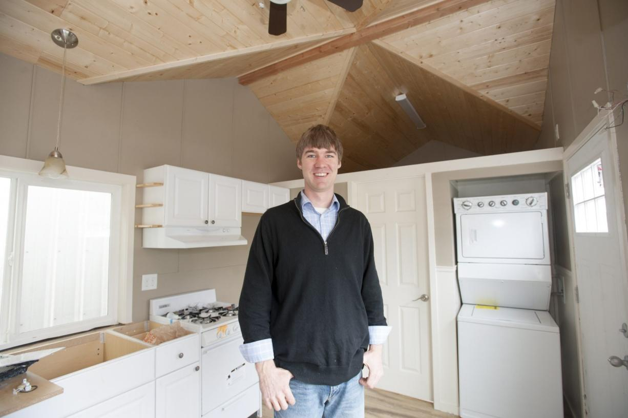 Derek Huegel, owner and founder of Wolf Industries in Battle Ground, is pursuing his latest project: tiny homes. Huegel is hoping to begin selling the homes, such as this 250-square-foot unit, later this year, but the homes aren't allowed currently in unincorporated Clark County. (Natalie Behring/The Columbian)