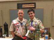 Jourdan Hale, right, receives his final three merit badges and his Order of the Arrow vigil feather recently with Ron Shake, eagle chair for the Boy Scouts of America's Columbia Gorge district.