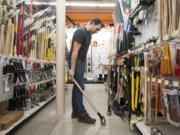 Werner Letsch, a customer at the new Parkrose Hardware store at 8000 E. Mill Plain Blvd., shops for sledge hammers.