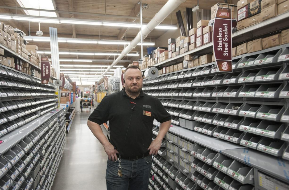 Parkrose Hardware store manager John Coppola stands among his store's expansive selection of nuts, bolts, and screws at the company's new store In Vancouver's North Garrison Heights neighborhood. The store, which boasts an inventory of more than 9,500 types of fasteners, will celebrate its grand opening this weekend.