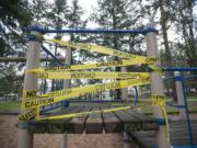 """A broken play structure at Cascade Park in Vancouver is wrapped in """"caution"""" tape. The city is spending $50,000 on new playground equipment for the park."""