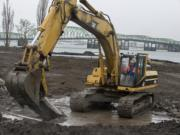 Stewart Brewer of Robertson & Olson Construction runs an excavator Wednesday at the downtown Vancouver waterfront area, preparing the site for the city's 7-acre park and Renaissance Trail extension.