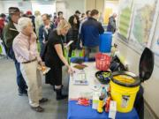 A crowd inspects emergency disaster kits Thursday at the Washington State University Vancouver campus.