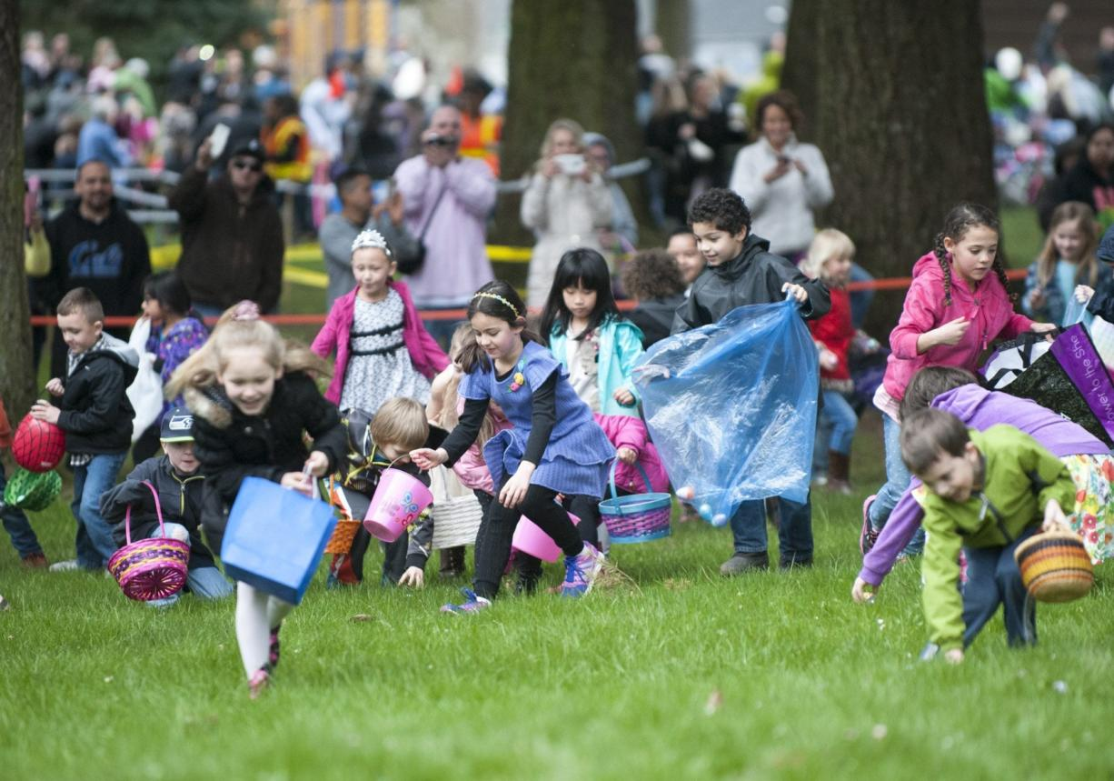 Children hurry to collect plastic eggs Sunday at an Easter egg hunt at Crown Park in Camas. About 2,000 people attended the free event.
