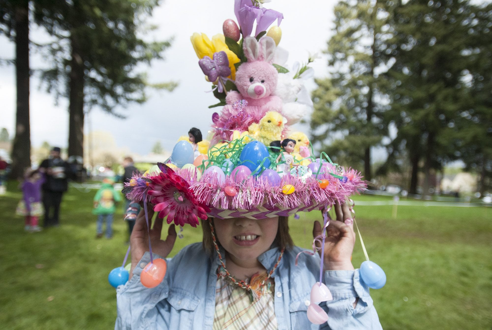 Jessica Rose, 9, wears a hat she decorated for an Easter bonnet competition Sunday at Crown Park in Camas. The girl took first place in her age group during the hat contest. (Photos by Natalie Behring/The Columbian)