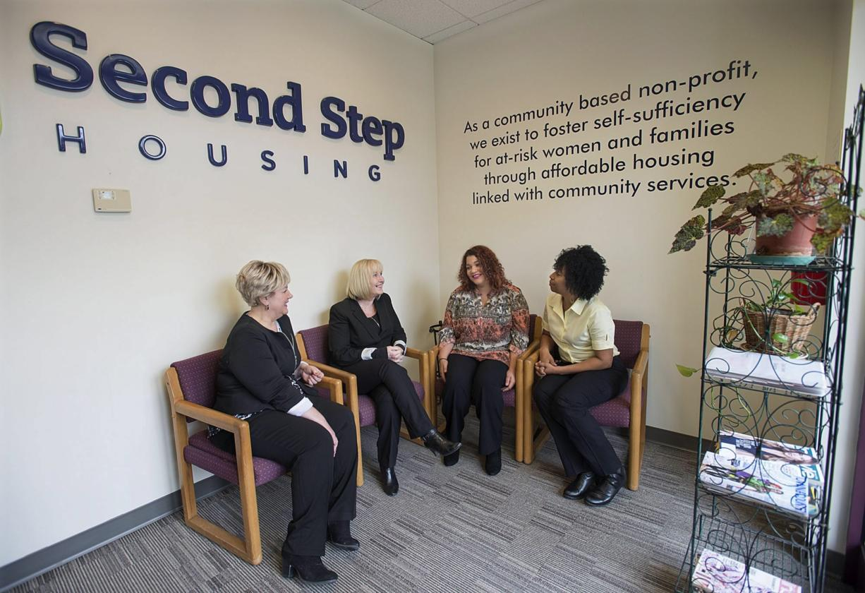 Denise Stone, from left, and Debby Dover of Second Step Housing chat with program client Amanda Owens and Armetta Burney of Clark College about their new partnership. The college can now directly refer homeless students to Second Step, which provides housing. (Amanda Cowan/The Columbian)