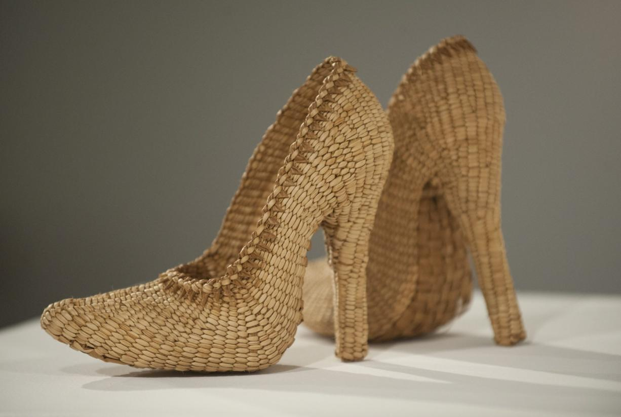 """A pair of high heels, titled """"Too Haida"""" by Lisa Telford, are on display at a contemporary native basketry exhibit at Clark College's Archer Gallery in Vancouver."""