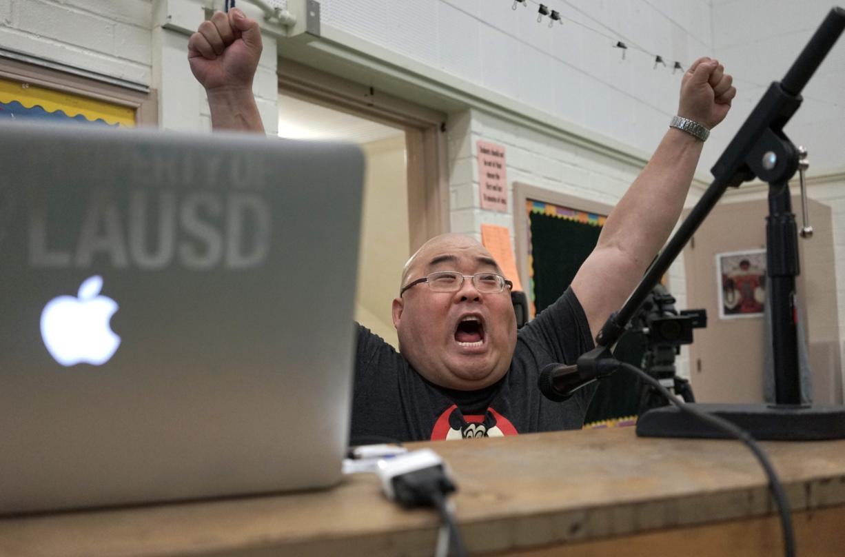 Teacher Steve Shin sings with students during a music class March 8 at Stevenson Middle School in East Los Angeles. (AP Photo/Christine Armario)