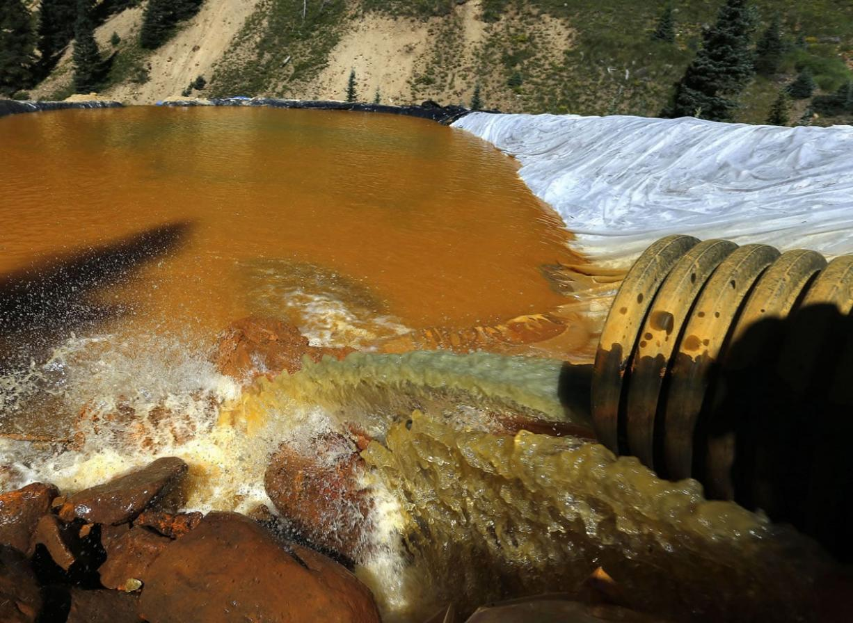 Water flows through a series of sediment retention ponds built to reduce heavy metal and chemical contaminants from the Gold King Mine wastewater accident, in the spillway about a quarter-mile downstream from the mine, outside Silverton, Colo.